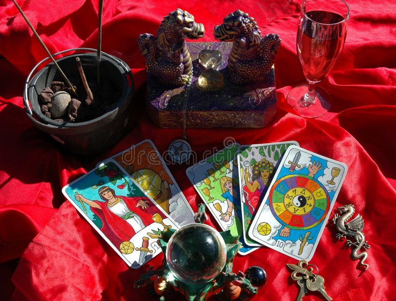Occult objects. Tarot cards and other items used in occult pursuits, such as spell casting royalty free stock images