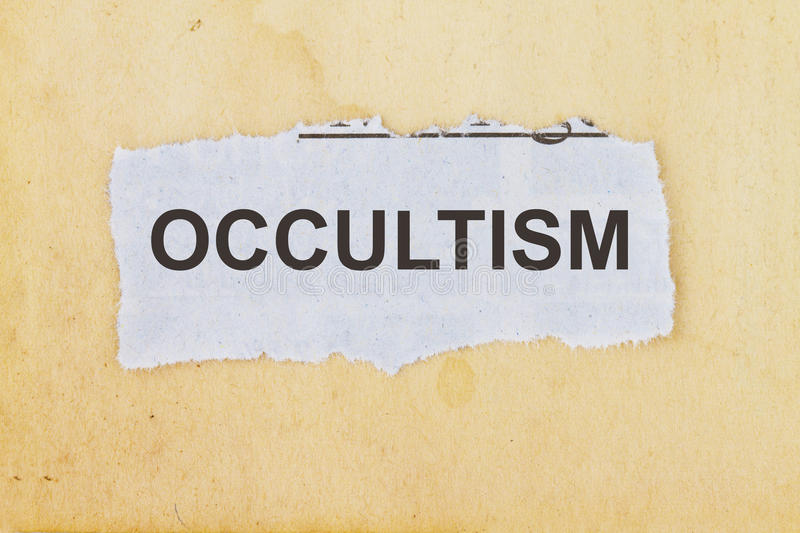 Occultism. Newspaper cutout in an old paper background stock image