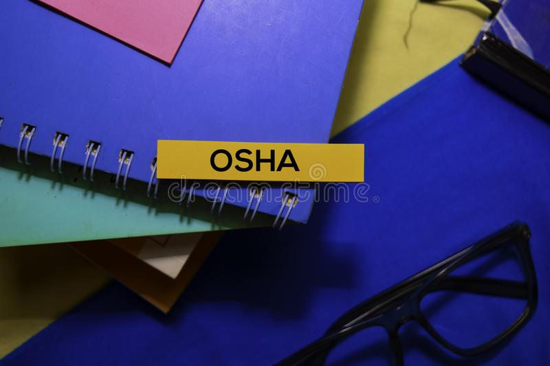 Occupational Safety and Health Administration Osha on sticky Notes isolated on Office Desk Background. stock photo