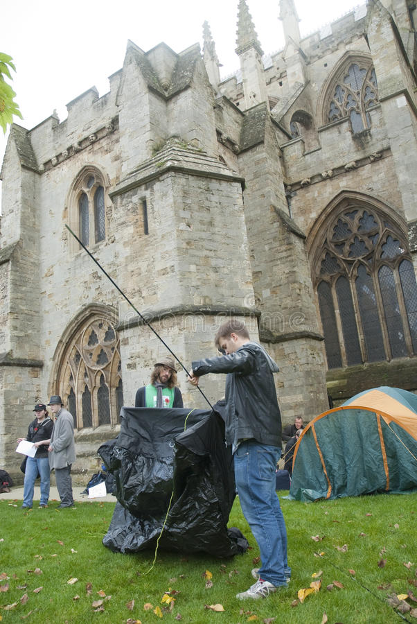 Occupy Exeter participants erect their tents