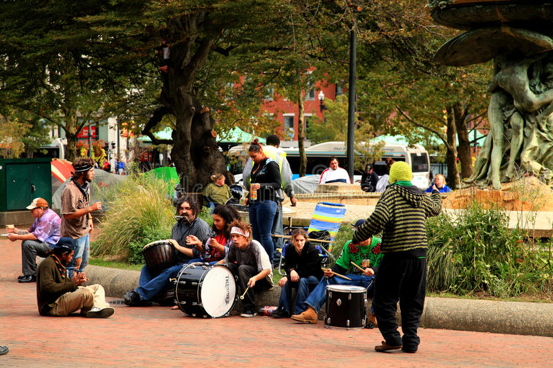 Occupy Providence. Young protesters pass the time by playing music in Burnside Park, Providence, Rhode Island royalty free stock photography
