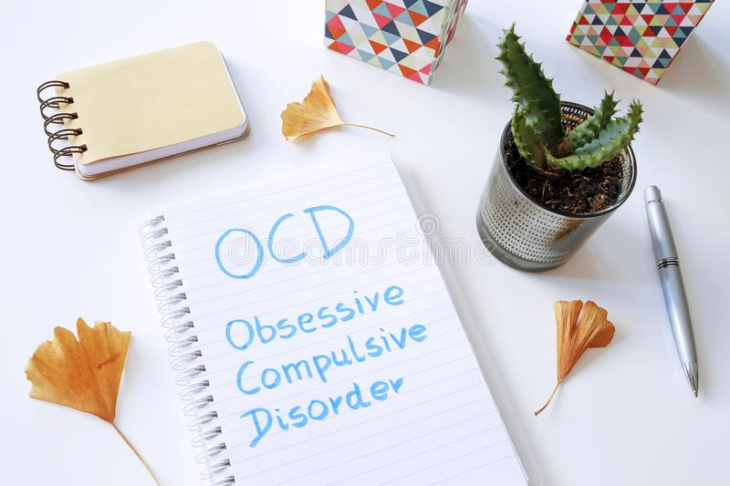 OCD Obsessive Compulsive Disorder written in notebook royalty free stock photos