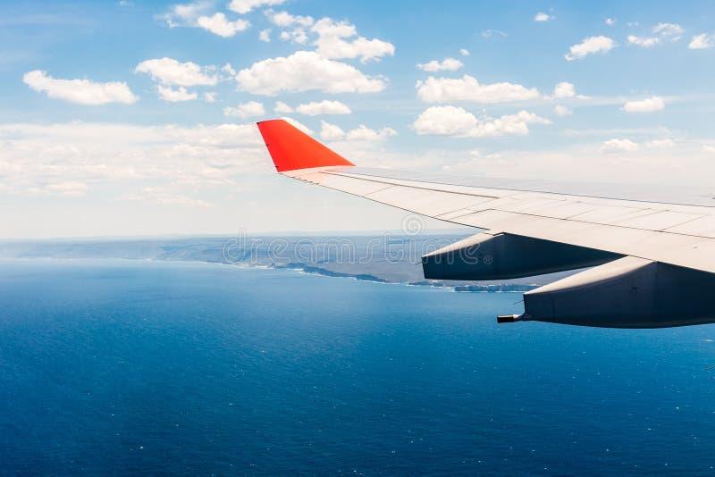 Oceaanmening van vliegtuigvenster over Australië royalty-vrije stock fotografie