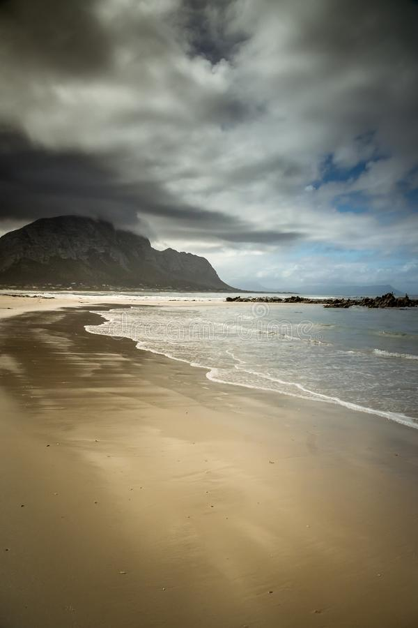 South Africa Beach Bay Ocean. Ocean Bay South Africa Bettys Bay Clouds Sky Salt Water Sun Summer Life Mountains Fog Haze royalty free stock photography