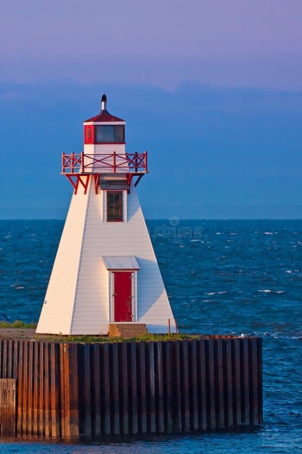 Ocean beacon at sunrise royalty free stock photography