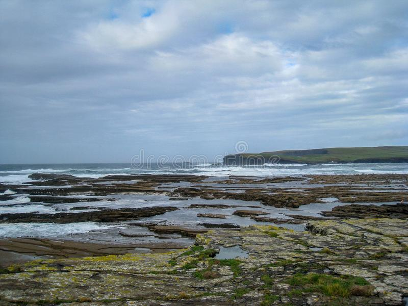 The Ocean Beyond the Rocks, Ireland. The Atlantic Ocean held at bay but the rocky coastline at Kilkee, Ireland royalty free stock image