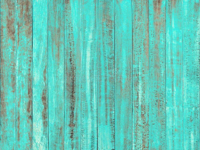 Ocean blue color peeling paint on vintage wood table