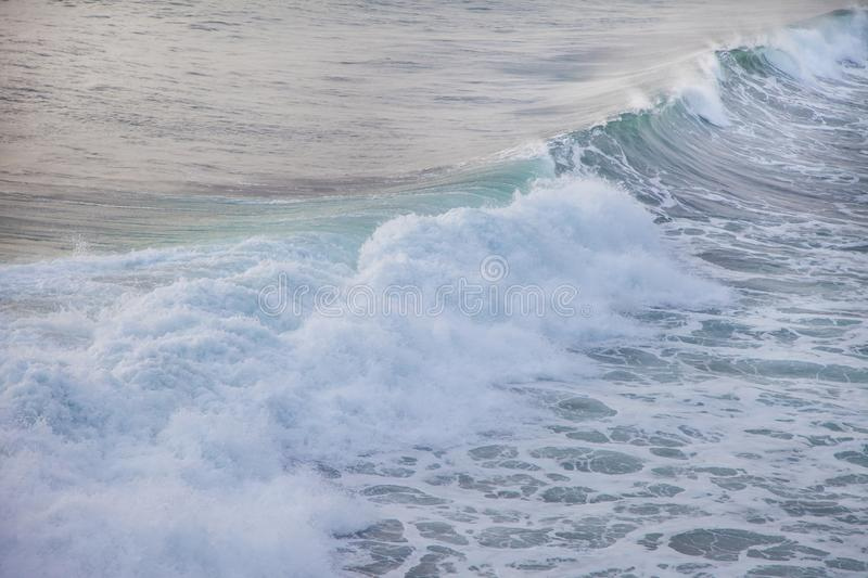 Ocean blue wave in ocean. Breaking wave for surfing in Bali. royalty free stock photography