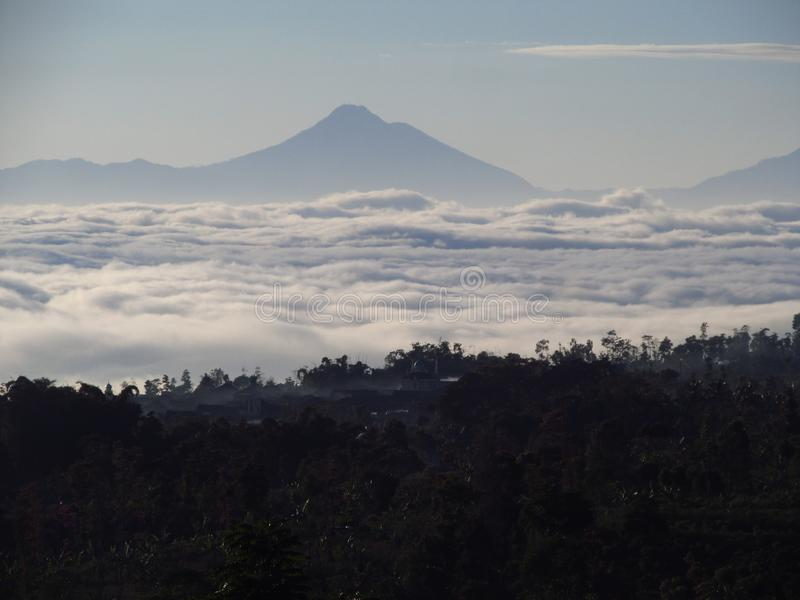 Ocean of clouds at Temanggung Central Java Indonesia. Morning view with ocean of clouds in my village at Temanggung Central Java Indonesia stock image
