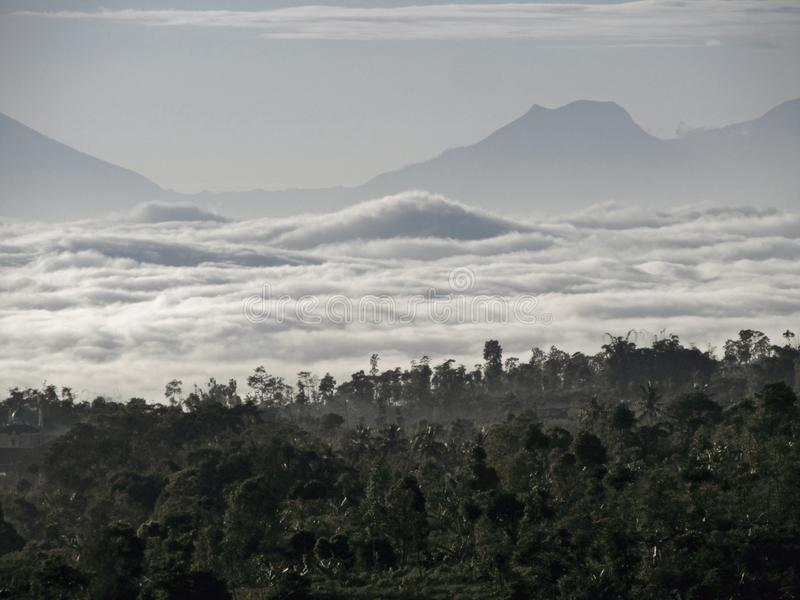 Ocean of clouds at Temanggung Central Java Indonesia. Morning view with ocean of clouds in my village at Temanggung Central Java Indonesia royalty free stock images