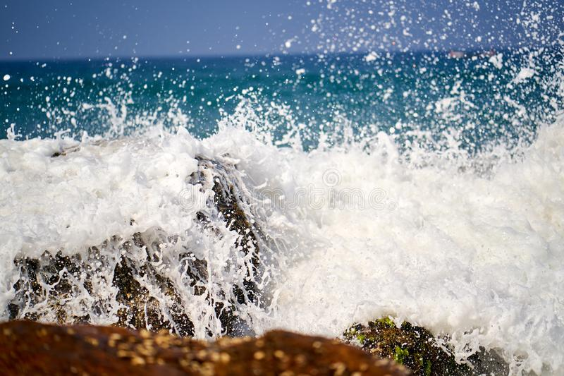 Ocean coast with big waves and rocks stock images