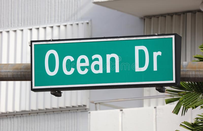 Ocean Dr green street sign at Miami beach Florida USA. Famous tourist destination summer break vacations royalty free stock image