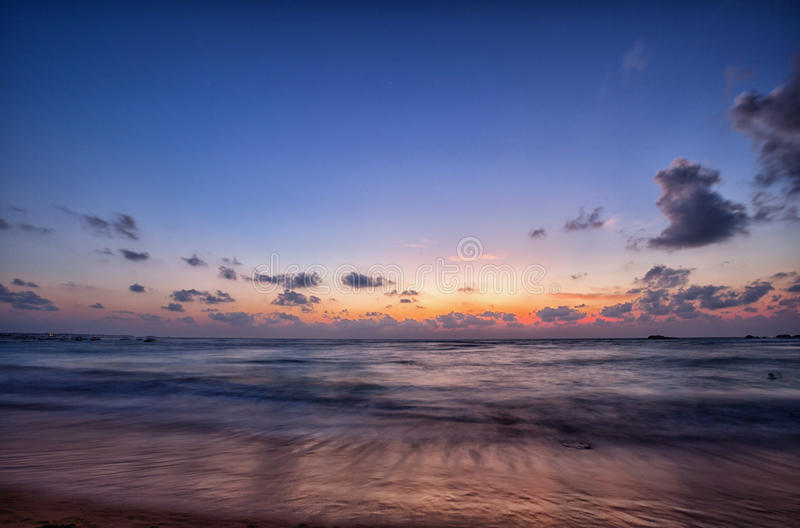 Ocean in the evening after sunset royalty free stock photography