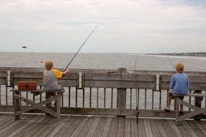 Ocean Fishing Pier Twins royalty free stock photos