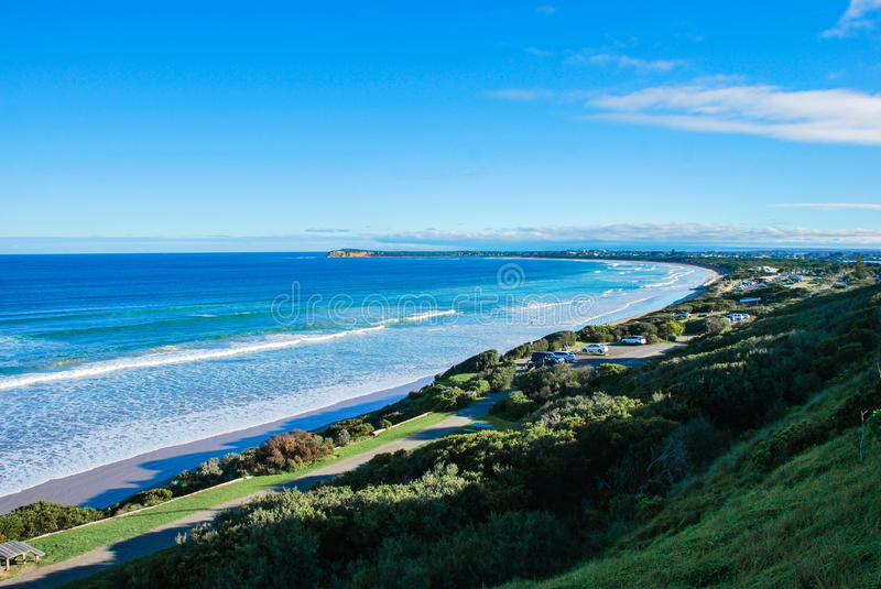 Ocean Grove Beach Australia. Catching the view of Barwon Heads, Barwon Bluff. Ocean and clear blue sky with some clouds, good weather with a lot of green stock images