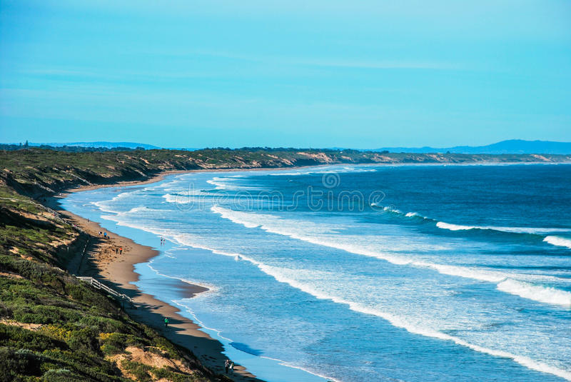 Ocean Grove Beach, Victoria, Australia. Ocean and clear blue sky with some clouds, good weather with a lot of green stock images