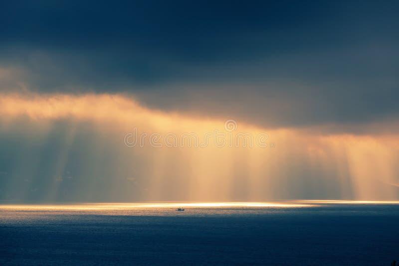 Ocean landscape, evening sunlight in dark sky. Atlantic ocean landscape, evening sunlight goes through dark cloudy sky. Retro style, colorful tonal correction stock photography