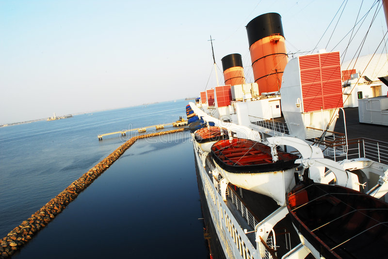 Ocean Liner. Large ocean liner anchored at a seaport stock photography