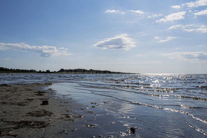 Ocean meets sky - horizon view. Photo looking out over the sea and sky from a beach a sunny summer day royalty free stock photography
