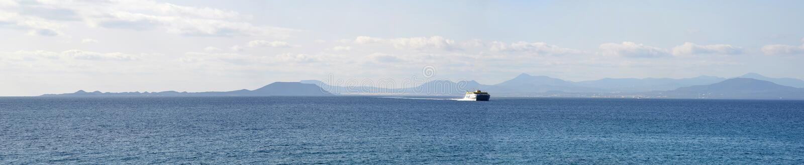 Ocean Panorama Ferry with the Northern Coast of Fuerteventura stock images