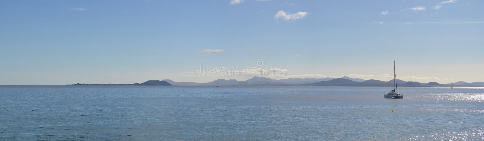 Ocean Panorama Yacht with the Northern Coast of Fuerteventura and the Island of Lobos. stock photos