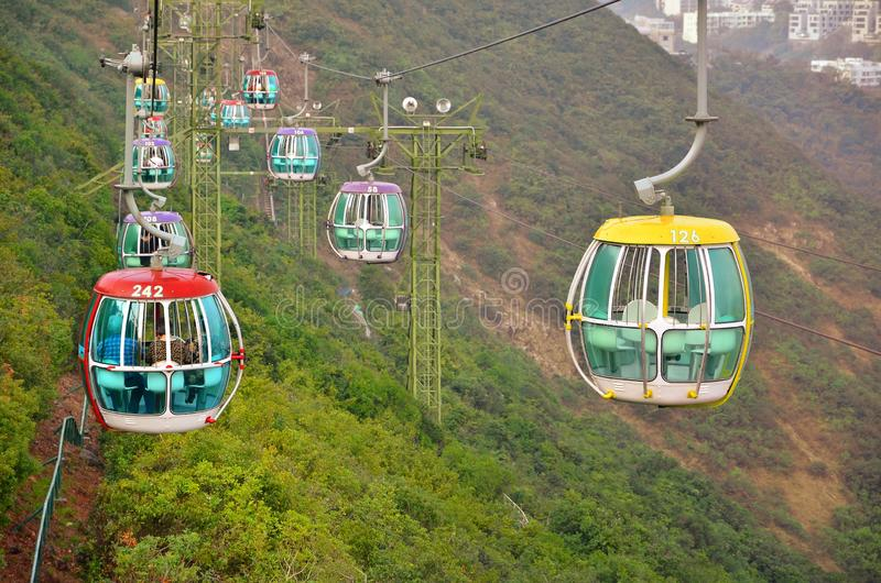 OCEAN PARK, HONGKONG - MARCH 15: Cablecar on march 15, 2018, Ocean Park, Hongkong. Cablecar carries tourists up to the. Entertainment park, trees, high, sky royalty free stock photo