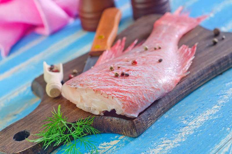 Ocean perch. On wooden board stock images