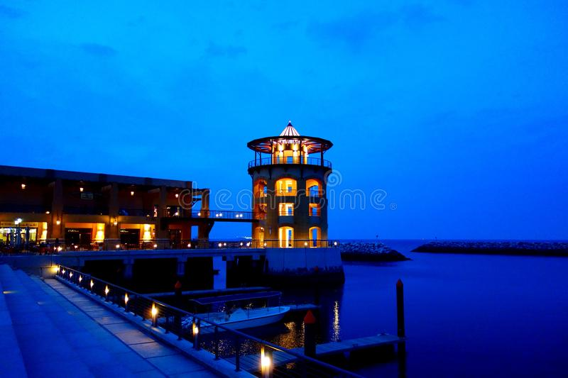 Ocean pier and docks at night stock photo