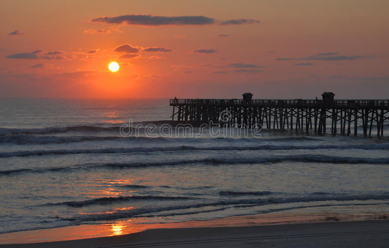 Ocean and Pier Sunrise (Sunset) stock photography