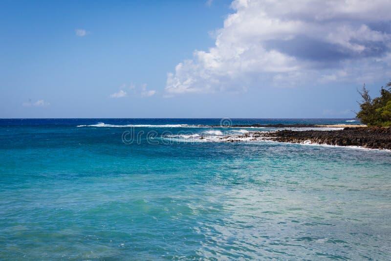 Ocean at Poipu Beach In Hawaii. Ocean at Poipu Beach, waves crashing on the rocks. Taken in Kauai, Hawaii royalty free stock photography