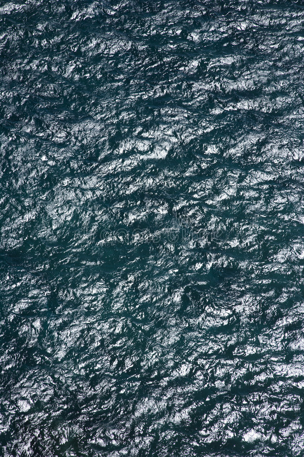 Ocean ripples. Ocean water rippling from above royalty free stock photos
