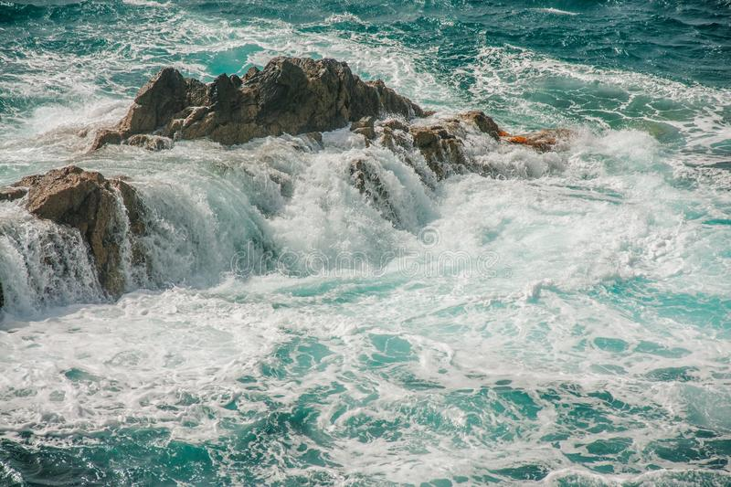 Ocean rock and wild waves royalty free stock photography