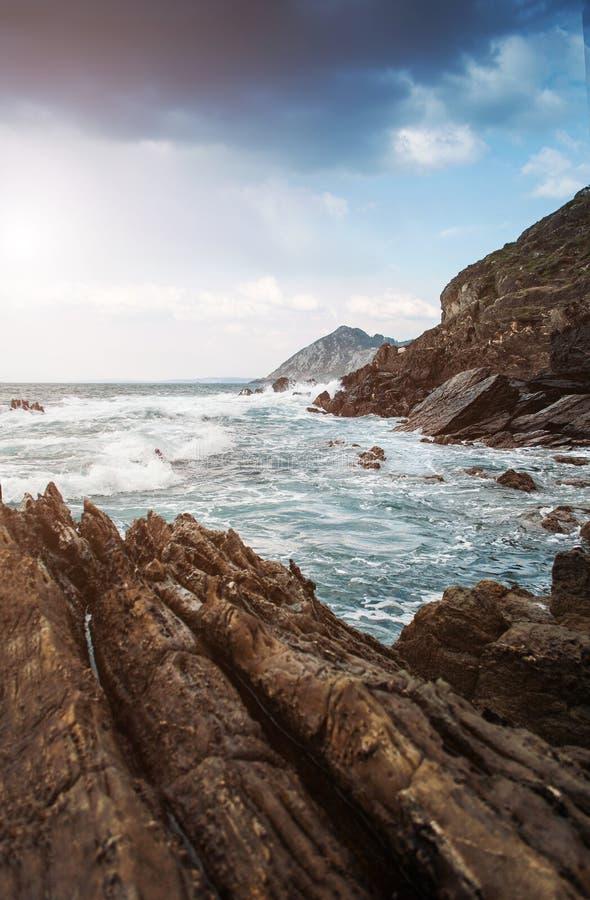 Ocean rocks wavews stock images