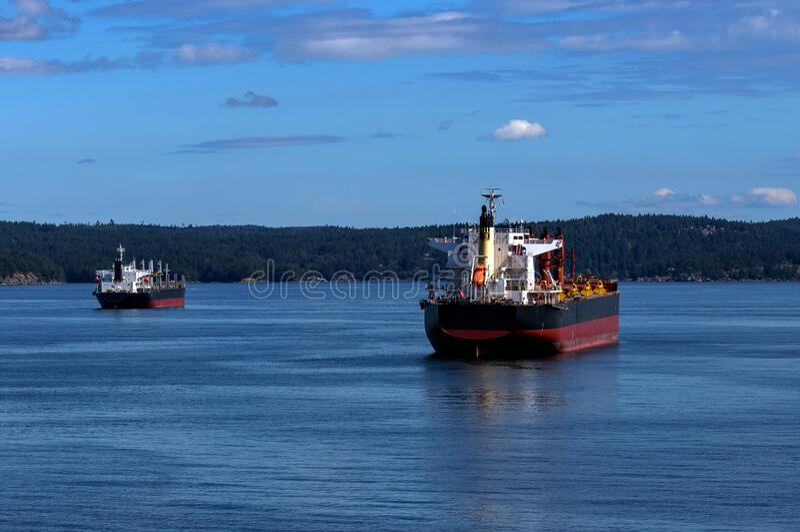 Ocean`s Tankers in Vancouver Harbor stock images