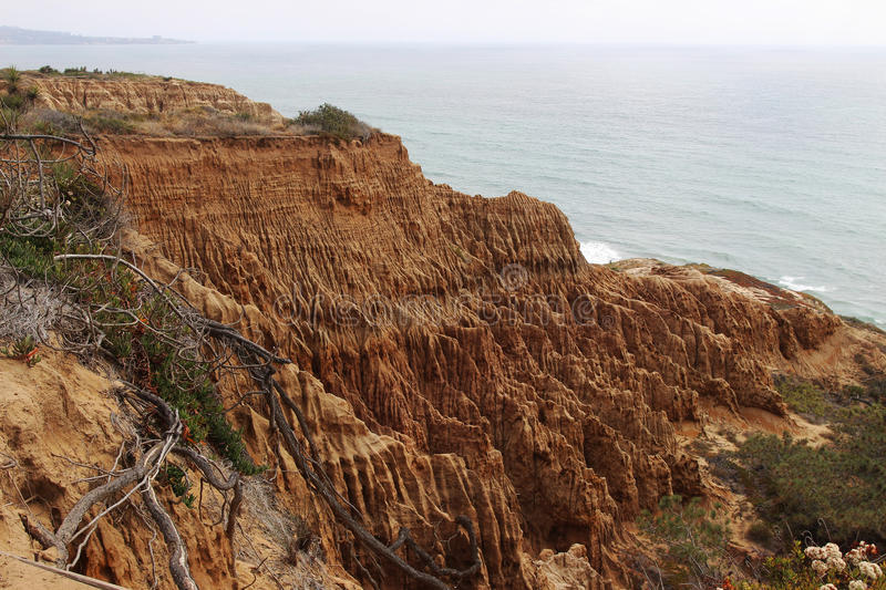 Ocean and sandstone cliff view royalty free stock photography