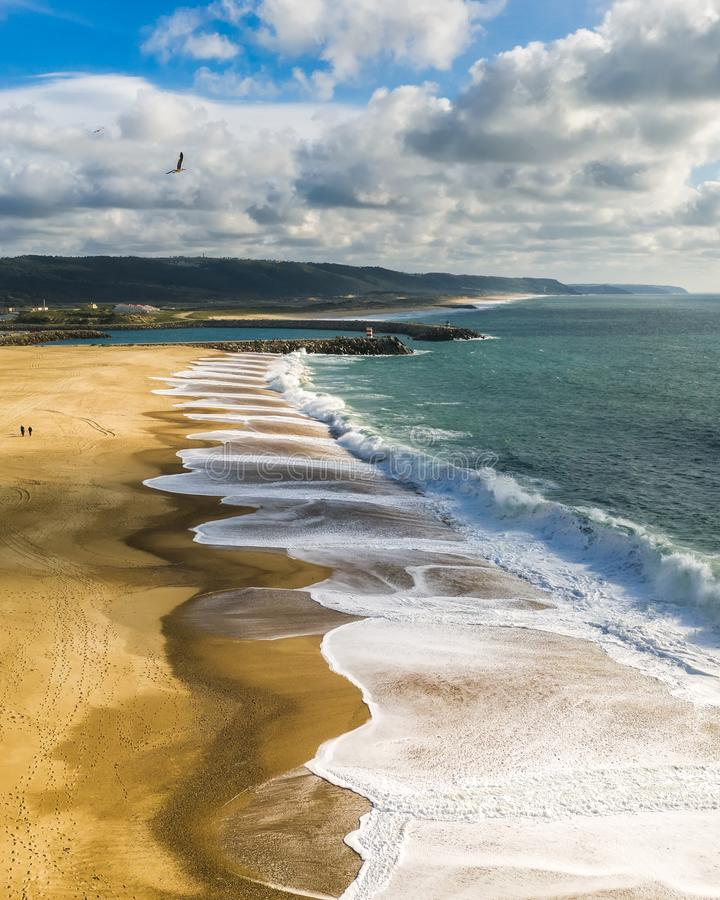 Ocean or sea foam and clean beach without people, summer cloudy panorama nature vertical. Ocean or sea foam and clean beach without people, summer cloudy royalty free stock images