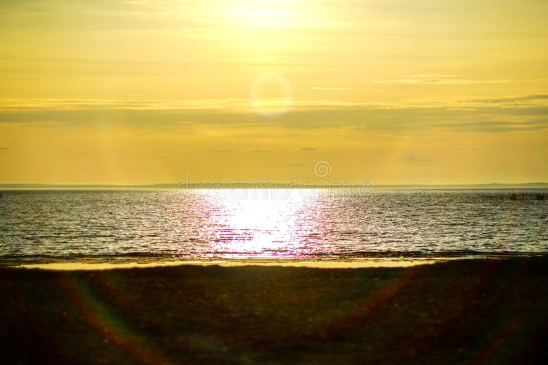 Ocean, sea sunset on the background of the sun going beyond the horizon.  beach and wonderful. Ocean, sea sunset on the background of the sun going beyond the royalty free stock photo