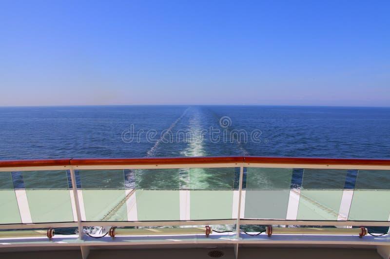 Ocean ship wake trail. With blue sky stock photos