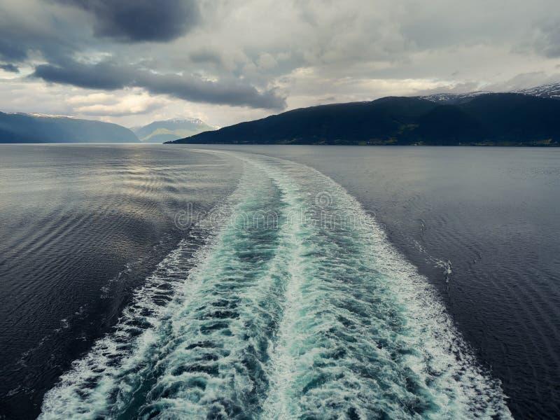 Ocean ship wake. Ship white wake on blue sea stock images