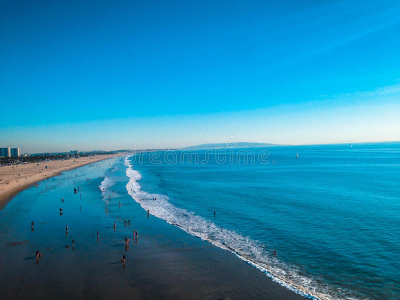 Ocean Shore. View of the ocean shore dotted with people stock photography