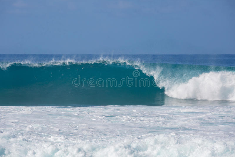 Ocean Shorebreak Wave Swell Front View. Shorebreak Big ocean wave in daylight. Beautiful sky with clouds. Sea Water surface for surfing sport. Nobody on picture royalty free stock images