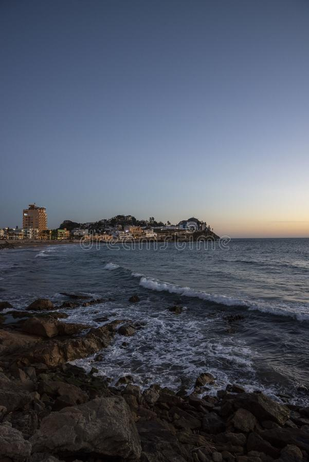 Ocean side with city. Night time lifestyle architecture royalty free stock images