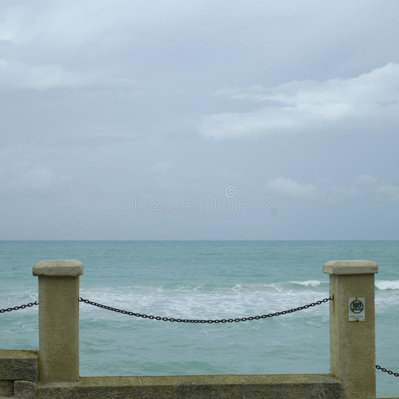 Ocean side fence royalty free stock images