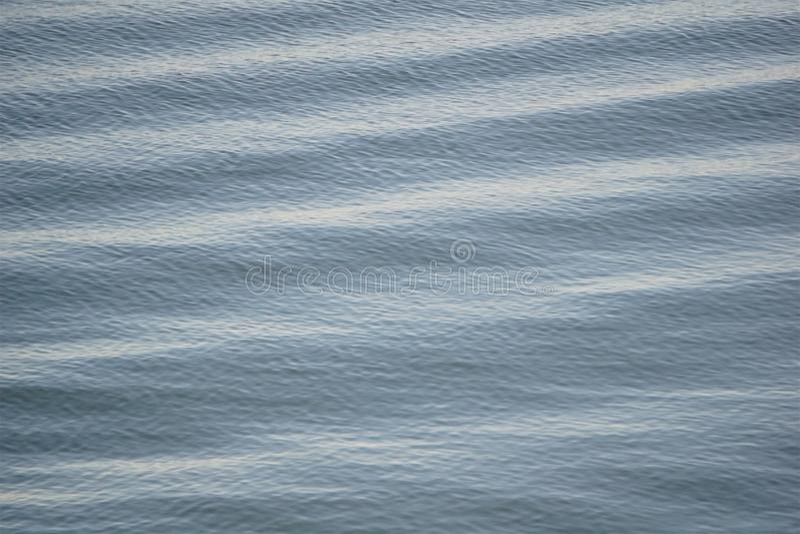 Ocean sine waves in gray stock photo