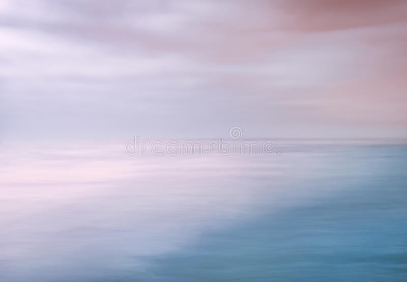 Ocean Sky Abstract. A seascape abstract made with panning motion combined with long exposure. Image displays soft contrast with split-tone colors stock photography