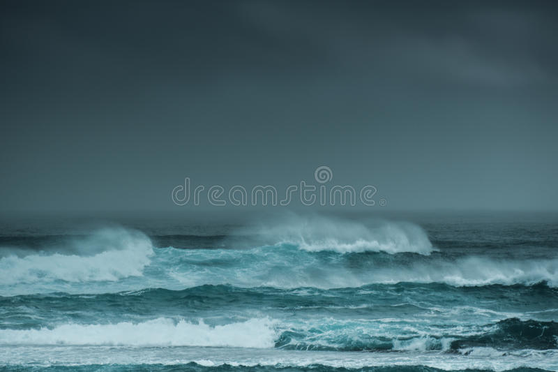Ocean storm Margaret River Western Australia. Ocean storm with waves and sea spray and dark cloudy sky Margaret River Western Australia royalty free stock image