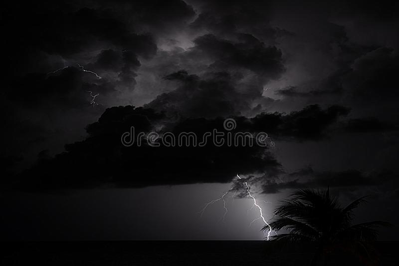 Ocean storms during the tropical summer often display dramatic bouts of thunder and lightning royalty free stock photos