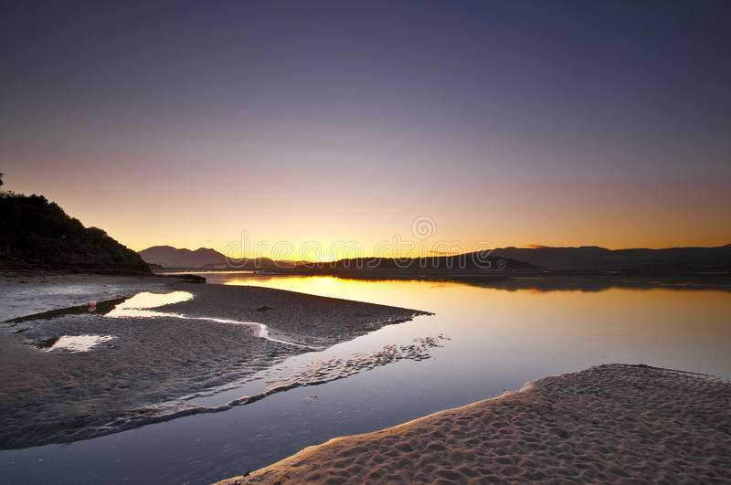 Ocean Sunrise. Sunrise over the ocean at Borth-Y-Gest, Wales, UK royalty free stock photos