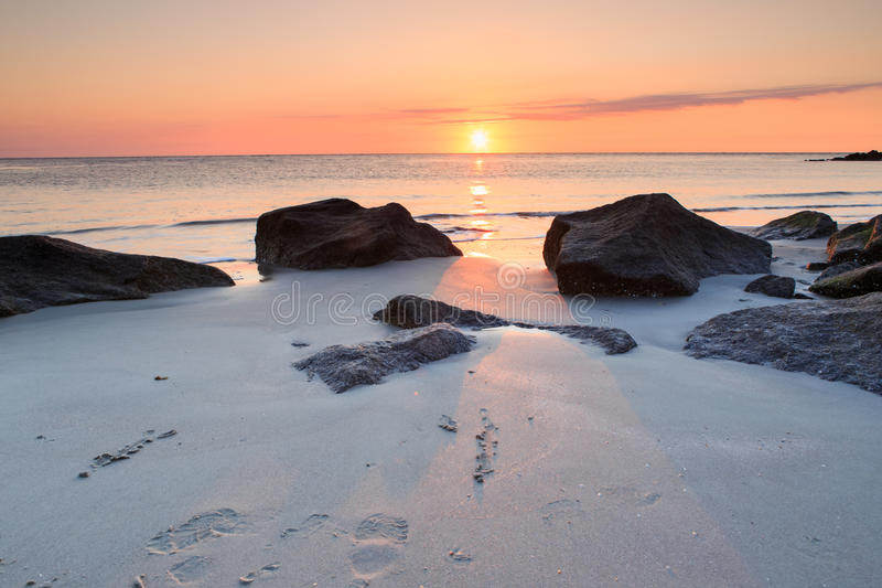 Ocean Sunrise Folly Beach South Carolina. Outdoor seascape of sunrise over the horizon of the Atlantic Ocean from the rocky coast of Folly Beach near Charleston royalty free stock image