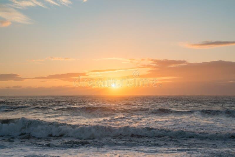 Ocean sunset blue orange rough seas waves dusk dawn. Sea stock photography
